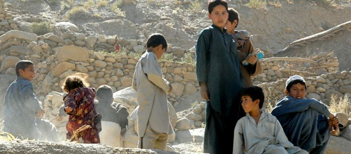 Afghanistan_children_play_hide_and_seek_with_the_camera_during_a_visit_by_the_38th_Infantry_Divisions_Task_Force_Cyclone